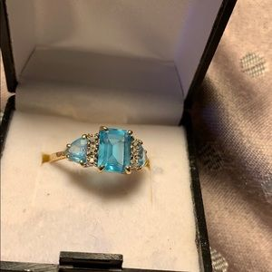 A3 stone Emerald cut blue topaz and diamond ring